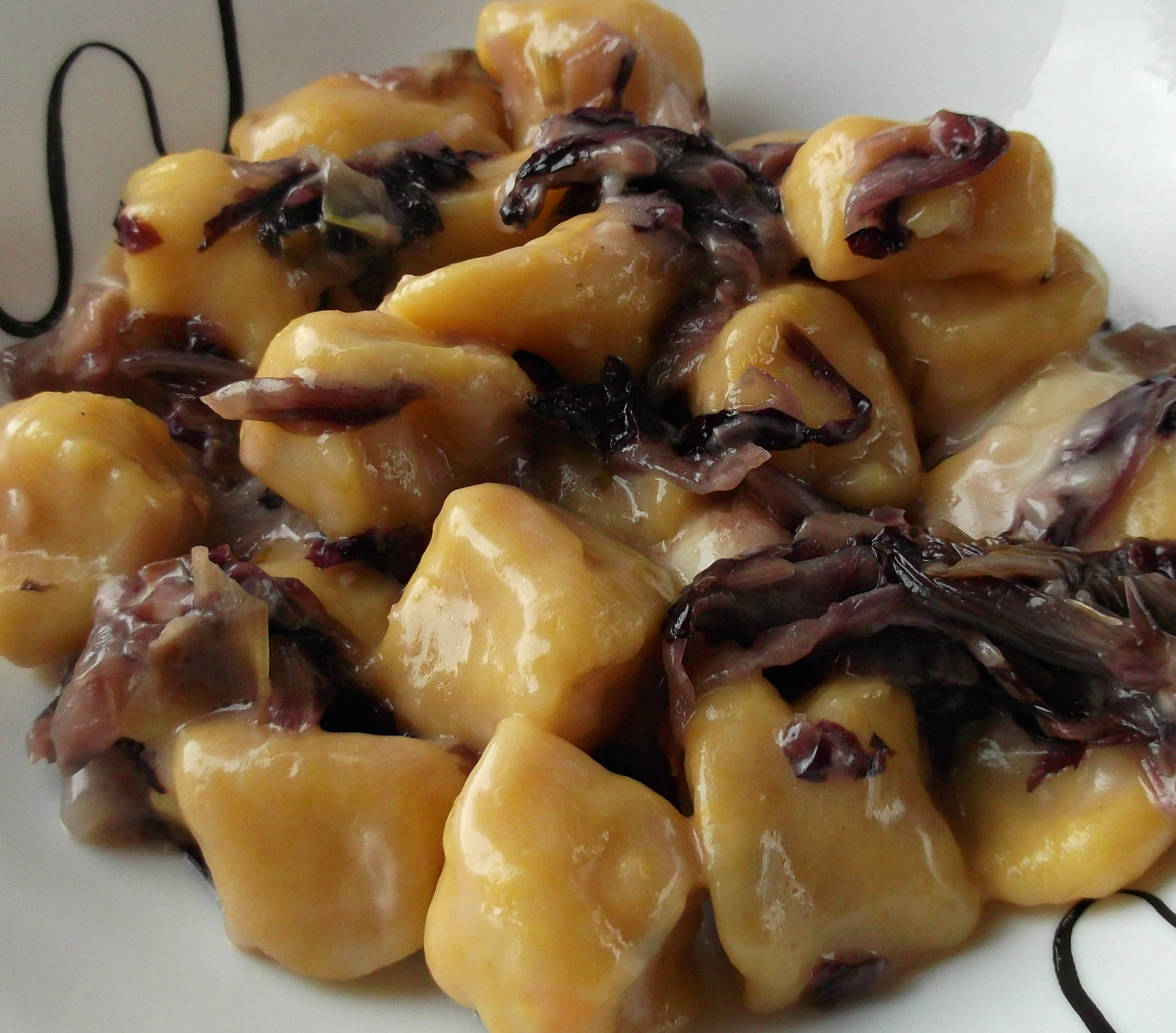 Gnocchi di zuccha con salsa di radicchio – Gnocchi van pompoen met radicchio saus
